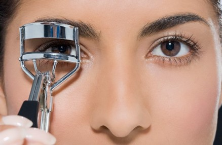 eyelash curlers in use